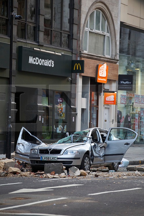 © licensed to London News Pictures. London, UK 15/02/2014. A woman has died after part of a building collapsed onto the car she was driving on High Holborn. The 49 year old female driver was pronounced dead at the scene. Photo credit: Tolga Akmen/LNP
