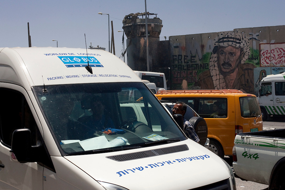 The van transporting the Picasso paint crosses the Kalandia checkpoint and passes in front a part of the concrete wall depicting a portrait of late Palestinian leader Yasser Arafat on June 19, 2011 in Ramallah...Photo by Olivier Fitoussi / Die Zeit