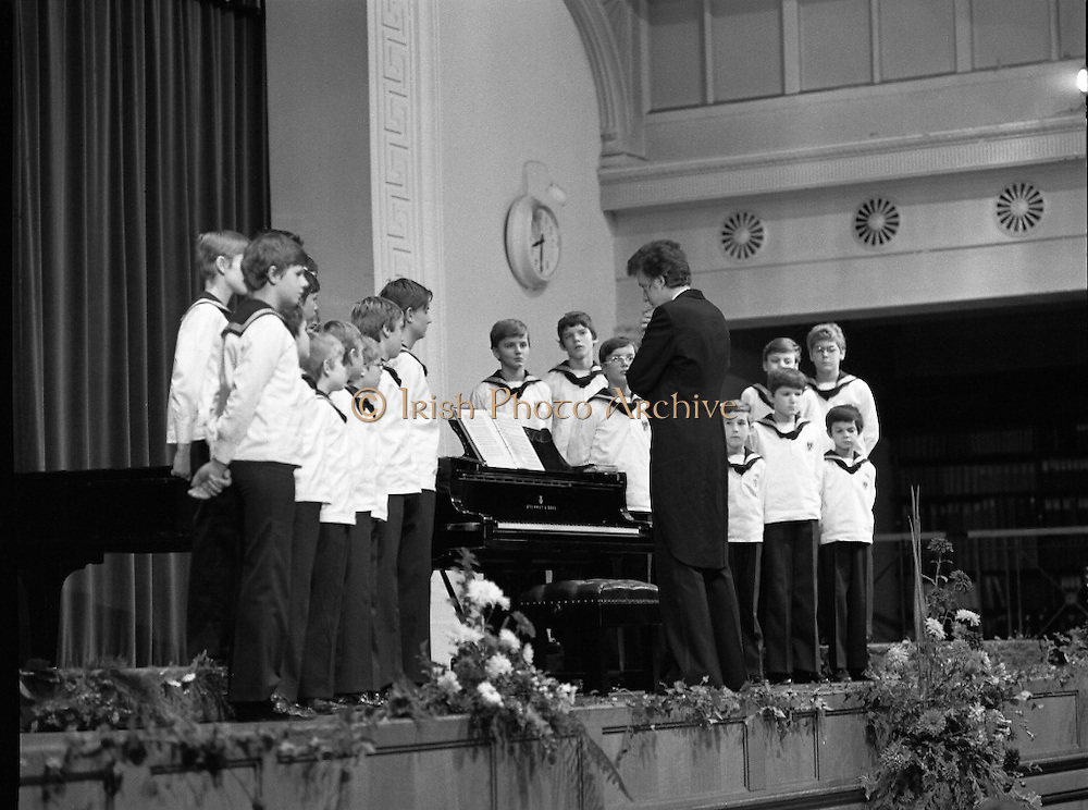 Vienna Boys Choir.   (P5)..1981..25.11.1981..11.25.1981..25th November 1981..The Vienna Boys Choir performed a concert at the Royal Dublin Showgrounds (RDS),Concert Hall,  Ballsbridge, Dublin, last night. A packed audience enjoyed the recital from the world renowned choir...Under the guidance of the director/pianist the choir is pictured performing for the packed audience at the RDS Concert Hall.