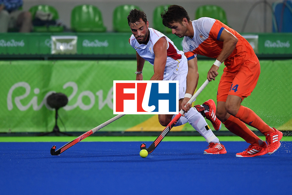 RIO DE JANEIRO, BRAZIL - AUGUST 16:   Sebastien Dockier of Belgium (L)  contests the ball with Robbert Kemperman of the Netherlands (R) during the Men's semifinal hockey match Belgium vs Netherlands at the Olympic Hockey centre on August 16, 2016 in Rio de Janeiro, Brazil.  (Photo by Pascal Le Segretain/Getty Images)