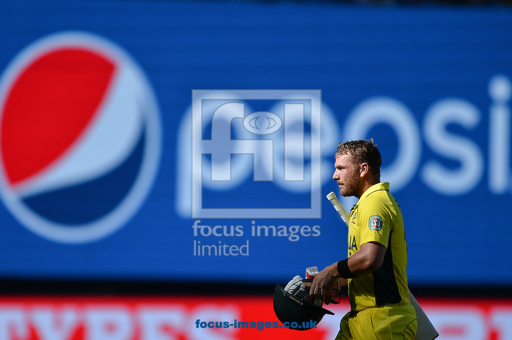 Aaron Finch of Australia leaves after been dismissed during the 2015 ICC Cricket World Cup match at Melbourne Cricket Ground, Melbourne<br /> Picture by Frank Khamees/Focus Images Ltd +61 431 119 134<br /> 14/02/2015
