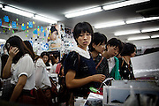 Tokyo, September 18 2011 - Inside a K-Pop department store, fans buy stickers and pictures of their idols. Korean mania reached Tokyo's Korean neighborhood near Shinokubo station. For a long time Japanese ladies in their 50ies have been interested in Korean televised dramas. Recently the success of K-Pop (Korean popular music) in Japan has brought a younger population in the neighborhood.