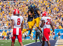 Sep 10, 2016; Morgantown, WV, USA; West Virginia Mountaineers wide receiver Ka'Raun White (2) celebrates with West Virginia Mountaineers wide receiver Daikiel Shorts (6) after scoring a touchdown during the first quarter against the Youngstown State Penguins at Milan Puskar Stadium. Mandatory Credit: Ben Queen-USA TODAY Sports