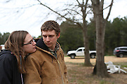 Melissa and Brandon Kennedy stand outside their home Saturday in Vina. The remoteness of their home and lack of access provided in Alabama requires the Kennedys to travel over 50 minutes to their OB-GYN appointments and to deliver their baby.