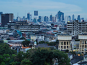 16 NOVEMBER 2013 - BANGKOK, THAILAND: The old historic part of Bangkok as seen from the top of Wat Saket during the annual temple fair. Wat Saket is on a man-made hill in the historic section of Bangkok. The temple has golden spire that is 260 feet high which was the highest point in Bangkok for more than 100 years. The temple construction began in the 1800s in the reign of King Rama III and was completed in the reign of King Rama IV. The annual temple fair is held on the 12th lunar month, for nine days around the November full moon. During the fair a red cloth (reminiscent of a monk's robe) is placed around the Golden Mount while the temple grounds hosts Thai traditional theatre, food stalls and traditional shows.    PHOTO BY JACK KURTZ