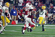 Green Bay Packers running back Eddie Lacy (27) outruns Arizona Cardinals outside linebacker Markus Golden (44) and Arizona Cardinals nose tackle Rodney Gunter (95) as he runs the ball for a gain of 61 yards for a first down and goal to go in the third quarter during the NFL NFC Divisional round playoff football game against the Arizona Cardinals on Saturday, Jan. 16, 2016 in Glendale, Ariz. The Cardinals won the game in overtime 26-20. (©Paul Anthony Spinelli)