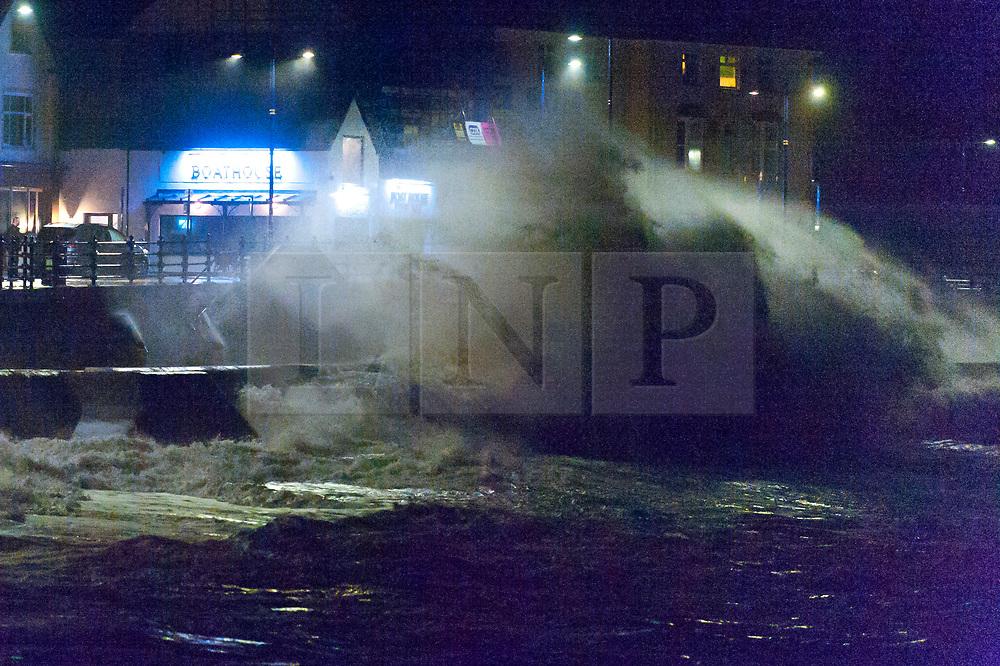 © Licensed to London News Pictures. 09/02/2020. Porthcawl, Bridgend, Wales, UK.  Massive waves poound the promenade in the Welsh seaside resort of Porthcawl in Bridgend, UK. Photo credit: Graham M. Lawrence/LNP