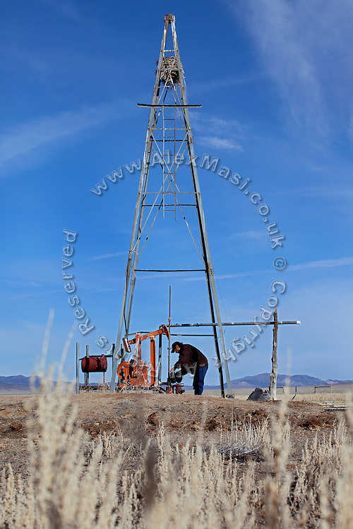 Clell Pete, 66, a member of the Goshute Tribe, is measuring the water table at an abandoned water hole near Eight Mile, in the Goshute Reservation of Deep Creek Valley, on the Nevada-Utah border, USA. Clell began measuring it once a week since November 2012, in order to document the development of the water table. As of March 2013, the water table is at 65,11 meters and has only varied by a few centimetres since November 2012. Once the projected water pipeline of South Nevada Water Authority (SNWA) will be built and operated from nearby Spring Valley, the Goshute tribe will be able to measure the acquifers. A considerable drop would also prove the Goshute's assumption is correct, and that in fact the aquifers of Spring Valley and Deep Creek Valley are interconnected: a water withdrawal from Spring Valley would also affect the water supply for nearby Deep Creek Valley, and for the Goshute Reservation.