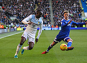 Albert Adomah of Aston Villa and Joe Bennett of Cardiff City during the EFL Sky Bet Championship match between Cardiff City and Aston Villa at the Cardiff City Stadium, Cardiff, Wales on 2 January 2017. Photo by Andrew Lewis.