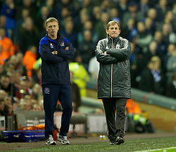 LIVERPOOL, ENGLAND - Tuesday, March 13, 2012: Liverpool's manager Kenny Dalglish, with Everton's manager David Moyes in the background, during the Premiership match at Anfield. (Pic by David Rawcliffe/Propaganda)