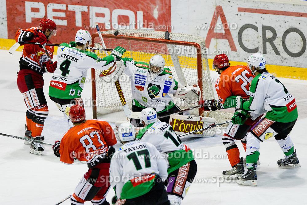 Jean-Philippe Lamoureux (HDD Tilia Olimpija, #1) with a save during of ice-hockey match between HK Acroni Jesenice and HDD Tilia Olimpija in 13th Round of EBEL league, on October 21, 2011 at Hala Tivoli, Ljubljana, Slovenia. (Photo By Matic Klansek Velej / Sportida)