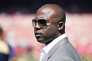 SAN FRANCISCO - SEPTEMBER 17:  Former running back Marshall Faulk of the St. Louis Rams, out for the season and perhaps his career with a knee injury, works the sidelines for NFL Network television prior to the Rams game against the San Francisco 49ers at Monster Park on September 17, 2006 in San Francisco, California. The Niners defeated the Rams 20-13. ©Paul Anthony Spinelli *** Local Caption *** Marshall Faulk