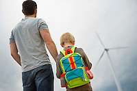 Father and son (7-9) at wind farm