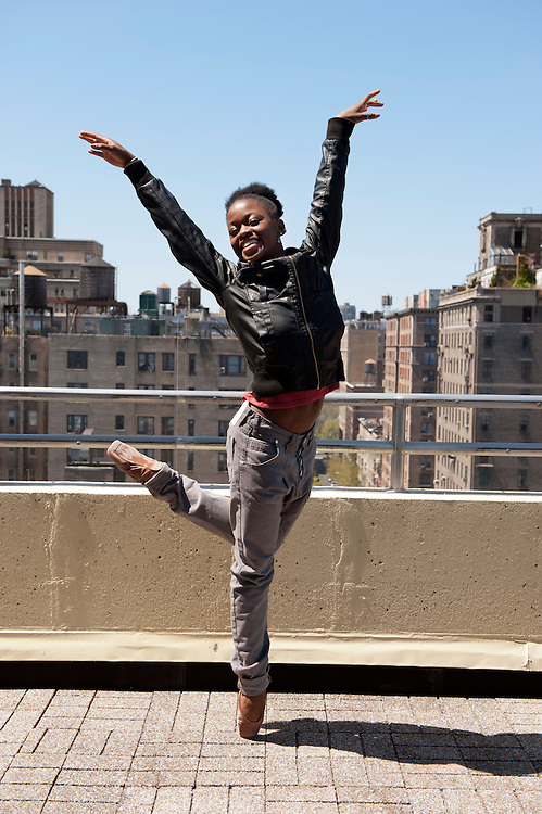 "Michaela DePrince at her home in Manhattan. ..Michaela DePrince was born in war-torn Sierra Leone on January 6, 1995 where she was named Named Mabinty Bangura. Her adoptive parents were told that her father was shot by rebels when she was three years old, and that her mother starved to death soon after. Frequently malnourished, mistreated, and derided as a ""devil's child"" because of vitiligo, a skin condition causing depigmentation, she fled to a refugee camp after her orphanage was bombed. In 1999, at age four, she and another girl, Mia, were adopted by Elaine and Charles DePrince from New Jersey, and taken to the United States. (source: Wikipedia)..Photo © Stefan Falke.www.stefanfalke.com"
