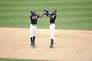 CHICAGO - JULY 09:  Juan Pierre #1 (L) and Alexei Ramirez #10 of the Chicago White Sox celebrate after Ramirez drove in the game winning run in the bottom of the ninth inning against the Minnesota Twins on July 9, 2011 at U.S. Cellular Field in Chicago, Illinois.  The White Sox defeated the Twins 4-3.  (Photo by Ron Vesely)  Subject: Juan Pierre;Alexei Ramirez