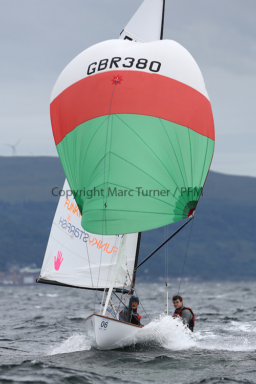 The Flying Dutchman World Championships,  Largs 2014. First days racing in breezy conditions on the Clyde. <br /> <br /> The former Olympic class has attract 40 worldwide competitors to Scotland to compete. <br /> GBR380, 	Julian Bridges , Jack Wild<br /> PIctures Marc Turner / PFM Pictures