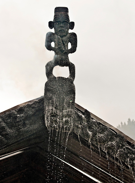 Firefighters foam runs like tears from the damaged faces of ancestral carvings after a blaze at the Mokau Marae, Whangaruru, Northland, New Zealand, Friday November 8, 2013. Credit:SNPA / Malcolm Pullman