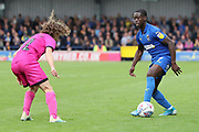 AFC Wimbledon defender Paul Osew (37) taking on Rochdale defender Luke Matheson (41) during the EFL Sky Bet League 1 match between AFC Wimbledon and Rochdale at the Cherry Red Records Stadium, Kingston, England on 5 October 2019.