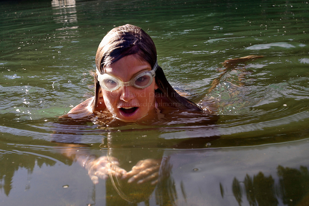 SQUAW VALLEY,  CA -  JULY 21:  2006 Olympic Gold Medal winner in the Womans Giant Slalom, Julia Mancuso, 22 relaxes in the pond behind her house on July 21, 2006 in Squaw Valley  California. Photo by David Paul Morris