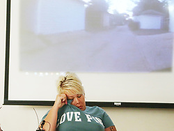 July 20, 2017 - Minneapolis, MN, US - During a press conference about a police body cam video released that shows dogs being shot by a Minneapolis police officer, the dogs owner Jennifer LeMay wipes away a tear while the video played during at the Minneapolis Urban League Wednesday, July 19, 2017, in Minneapolis, MN.] ......DAVID JOLES • david.joles@startribune.com.... about police body cam video being released that shows dogs being shot by police.** Jennifer LeMay,Mike Padden, cq. (Credit Image: © David Joles/Minneapolis Star Tribune via ZUMA Wire)