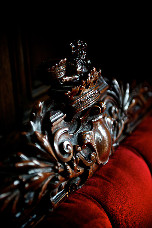 Wood carving adorning a bench in the entry of Kylemore Abbey in county Galway, Ireland.