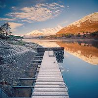 Crisp winter's morning in Glen Affric looking over a frozen jetty