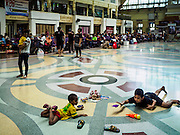 26 FEBRUARY 2017 - BANGKOK, THAILAND:  Children play on the floor in Hua Lamphong Train station in Bangkok. The station opened in 1916 as Bangkok's main train station. It is scheduled to be closed and turned into a museum in the next two years. At that time, the main train station will move to the Bang Sue area of Bangkok.        PHOTO BY JACK KURTZ
