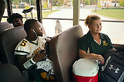 "BIRMINGHAM, AL – SEPTEMBER 11, 2015: Sonya Whitaker (right) sits near Woodlawn receiver Quintarius Monroe (center) on the way to a high school football game. ""I tray to stay back and let him come to me if he gets in trouble. I'm diabetic too."" As a type 1 diabetic, Quintarius Monroe requires frequent blood sugar testing and supervision when self-administering insulin. When care from qualified personnel at his school in Center Point became unavailable, Monroe was forced to transfer several miles away from his locally zoned school to attend Woodlawn High School. The Americans with Disabilities Act requires schools to provide ""reasonable accommodation"" for students with medical conditions, but given that most schools no longer retain school nurses, many schools are failing to provide adequate care for their students.<br />