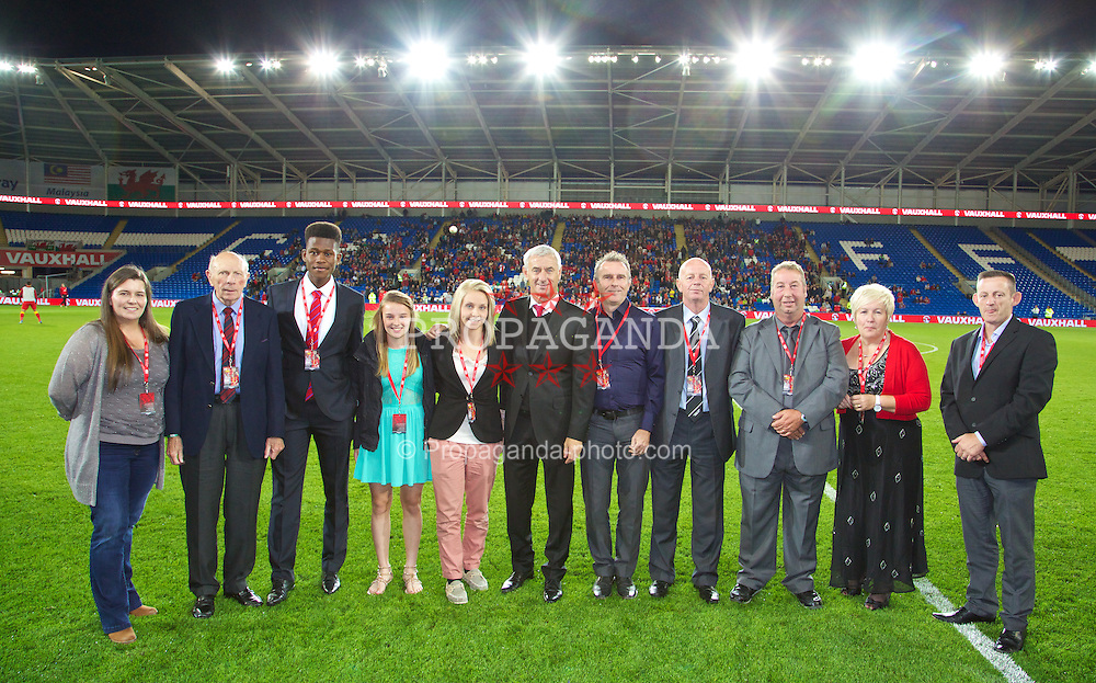 CARDIFF, WALES - Tuesday, September 10, 2013: Community award winners with Ian Rush during the 2014 FIFA World Cup Brazil Qualifying Group A match between Wales and Serbia at the Cardiff CIty Stadium. (Pic by David Rawcliffe/Propaganda)