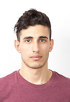 Portrait of young Middle Eastern man over white background