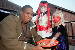 Guinness Northern Counties Housing Associations Godley Street  Scheme Hold a Halloween Street Party.Guinness Northern Counties Brian Hamlin hands out treats to the kids.30 October 2010 .Images © Paul David Drabble