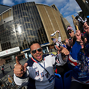 April 17, 2014:  A general view of the exterior of Madison Square Garden with New York Rangers fans celebrating on top of the Party Bus during the first round playoff game between The New York Rangers and The Philadelphia Flyers at  Madison Square Garden in Manhattan, New York .  (Credit Image: © Kostas Lymperopoulos/Cal Sport Media)