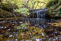 PICTURED ROCKS NATIONAL LAKESHORE - October 2016: Just up steam from where Bridalveil Falls cascades over the cliff edge is this small un-named waterfall in Pictured Rocks national Lakeshore. Its an off trail hike but not difficult if you follow the stream. Photographer Bryan Mitchell was this years Artist in Residence at Pictured Rocks National Lakeshore in the Upper Peninsula of Michigan from Oct. 1-17, 2016 near Munising, Michigan. (Photo by Bryan Mitchell)