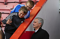Football - 2018 / 2019 Premier League - AFC Bournemouth vs. Manchester United<br /> <br /> Manchester United Manager Jose Mourinho poses with a couple of young fans for a selfie at the Vitality Stadium (Dean Court) Bournemouth <br /> <br /> COLORSPORT/SHAUN BOGGUST