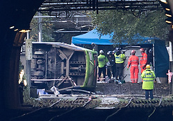 © Licensed to London News Pictures. 09/11/2016. London, UK. A tram (L) can be seen lying on it's side after it derailed near Sandilands tram station in Croydon, Greater London. Dozens of people are believed to be injured with emergency services saying that there has been a number of fatalities . Photo credit: Peter Macdiarmid/LNP