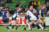 Siyamthanda Kolisi (Stormers) takes on Bryce Hegarty (Rebels) during the Round 14 match of the 2013 Super Rugby Championship between RaboDirect Rebels vs DHL Stormers at AAMI Park, Melbourne, Victoria, Australia. 17/05/0213. Photo By Lucas Wroe