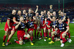 The Saracens team celebrate with the European Rugby Champions Cup trophy - Mandatory byline: Patrick Khachfe/JMP - 07966 386802 - 14/05/2016 - RUGBY UNION - Grand Stade de Lyon - Lyon, France - Saracens v Racing 92 - European Rugby Champions Cup Final.