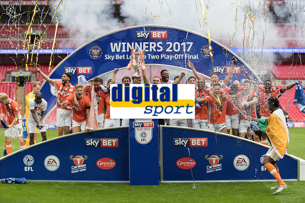 Football - 2017 Sky Bet [EFL] League Two Play-Off Final - Blackpool vs. Exeter City<br /> <br /> Blackpool players celebrate on the podium at Wembley.<br /> <br /> COLORSPORT/DANIEL BEARHAM