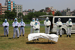 "April 7, 2020, Dhaka, Bangladesh: With great respect and care a team of gravediggers and health workers, dressed in full protective suits, say final words and bury the body of coronavirus victim, JALAL SAIFUR RAHMAN, the director of the Banglandish Anti-Corruption Commission (ACC). Jalal, a director of Bangladesh government's main anti-graft body, had tested positive for COVID-19 seven days ago. Dr. Shihab Uddin, superintendent of Kuwait Bangladesh Friendship Government Hospital, one of the dedicated hospitals for treating coronavirus-infected patients in Bangladesh, said: ""He was in a intensive care unit of the hospital and last late night his blood pressure fell down rapidly. We tried our level best. But today [Monday] at 7.30 a.m. he died."" Bangladesh on Monday, reported 29 new coronavirus patients and four new deaths, raising the total number of confirmed cases in the country to 123 and death toll to 13. Since appearing in Wuhan, China last December, the novel coronavirus has spread to at least 183 countries and regions, killed scores and infected millions. (Credit Image: © Sultan Mahmud Mukut/SOPA Images via ZUMA Wire)"