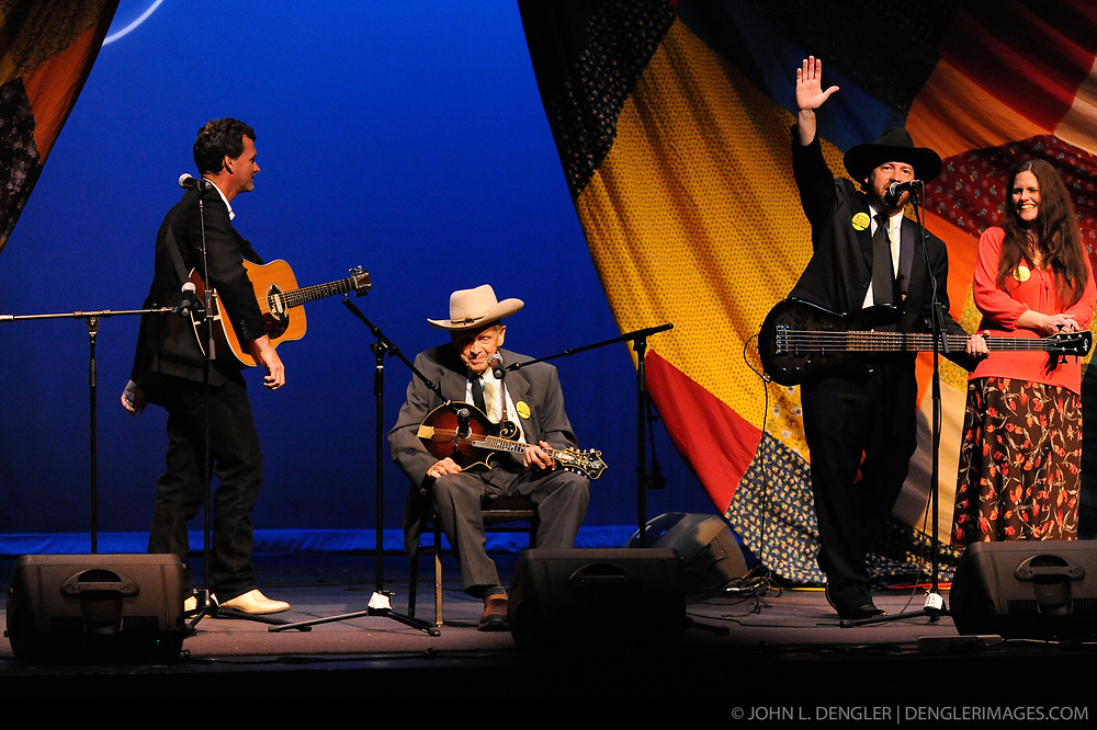 Everett Lilly (center, with mandolin) smiles after he and his two sons Mark (left) and Daniel (right) along with Beth Sparks conclude their performance at the West Virginia State Theater at the Vandalia Gathering in Charleston, West Virginia. At the event Everett Lilly received the 2009 Vandalia Award, considered West Virginia's highest folklife honor. Everett Lilly is a former Grand Ole Opry star who peformed with Flatt & Scruggs. Lilly is considered one of the forefathers of bluegrass music and is credited with bringing bluegrass to the New England area.