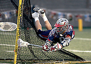 (Boston, MA - June 15, 2007) - Boston Cannons forward Mikey Powell leaps across the back of the net to slide the ball past New Jersey Pride goalie Rob Scherr. The Pride won the game 13-10...Staff Photo Will Nunnally/The Boston Cannons.