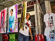 04 NOVEMBER 2015 - YANGON, MYANMAR:  Selling Aung San Suu Kyi merchandise in Yangon. National elections are scheduled for Sunday Nov. 8 in Myanmar. The two principal parties are the National League for Democracy (NLD), the party of democracy icon and Nobel Peace Prize winner Aung San Suu Kyi, and the ruling Union Solidarity and Development Party (USDP), led by incumbent President Thein Sein. There are more than 30 parties campaigning for national and local offices.        PHOTO BY JACK KURTZ