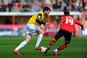 Northampton Town's Brendan Moloney and Exeter City's Alex Nicholls during the Sky Bet League 2 match between Exeter City and Northampton Town at St James' Park, Exeter, England on 16 April 2016. Photo by Graham Hunt.