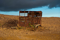 Rusted horse trailer on a farm at Ka Lae, South Point, Hawaii