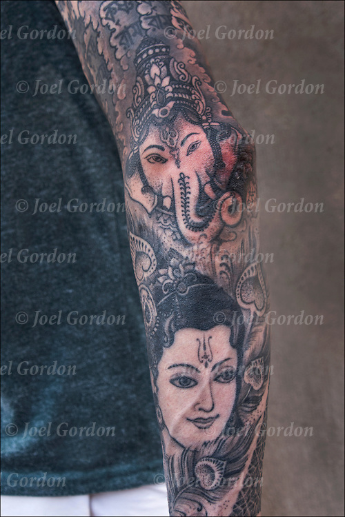 Hindu Tattoos on Michael Ferranti's left arm. His Hare Krisha name is Kanubhai Da.<br /> <br /> The tattooists JonDix Mahashakti at Seven Doors Tattoo London and Thomas Hooper at Rock of Ages in Rock of Ages Tattooing in Austin, TX.<br /> <br /> Body art or tattoos has entered the mainstream it is no longer considered a weird kind of subculture.<br /> <br /> &quot;According to a 2006 Pew survey, 40% of Americans between the ages of 26 and 40 have been tattooed&quot;.<br /> <br /> release # 2714