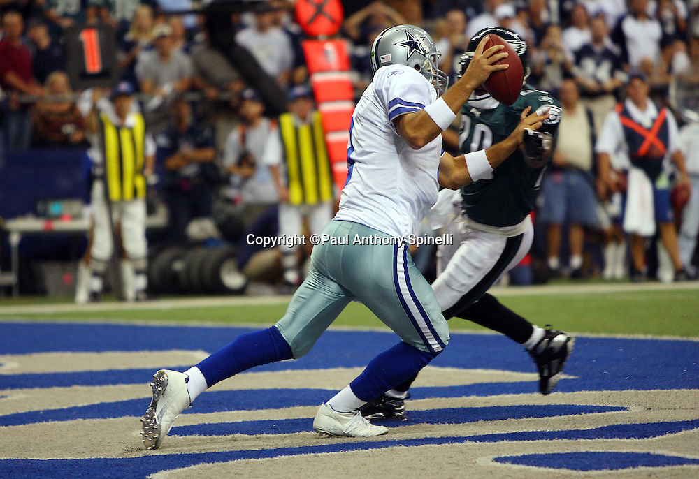 IRVING, TX - SEPTEMBER 15:  Quarterback Tony Romo #9 of the Dallas Cowboys scrambles while being chased in the end zone by free safety Brian Dawkins #20 of the Philadelphia Eagles at Texas Stadium on September 15, 2008 in Irving, Texas. The Cowboys defeated the Eagles 41-37. ©Paul Anthony Spinelli *** Local Caption *** Tony Romo;Brian Dawkins