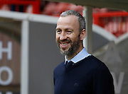Shaun Derry, Manager of Cambridge United has a pre match smile on his face as his players share a joke with him before the Sky Bet League 2 match between Crawley Town and Cambridge United at the Checkatrade.com Stadium, Crawley, England on 9 January 2016. Photo by Andy Walter.