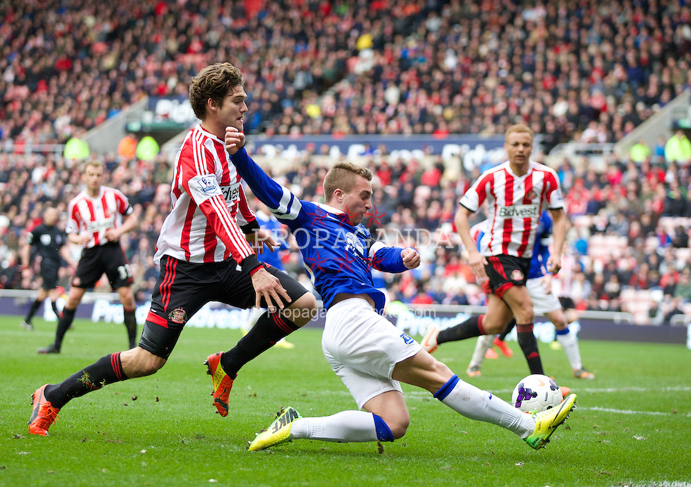SUNDERLAND, ENGLAND - Saturday, April 12, 2014: Everton's Gerard Deulofeu crosses the ball which Sunderland's Wes Brown turns into his own net for an own-goal during the Premiership match at the Stadium of Light. (Pic by David Rawcliffe/Propaganda)