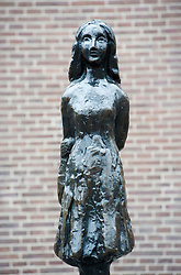 Staue of Anne Frank outside her former house in Amsterdam Netherlands