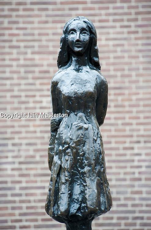 Staue of Anne Frank outside her former house in Amsterdam Netherlands
